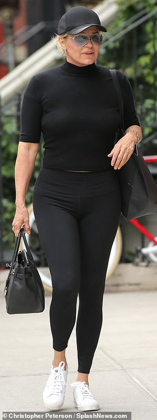Nice in neutrals: The Dutch-born beauty donned a mock turtleneck that matched her black leggings earlier in the day