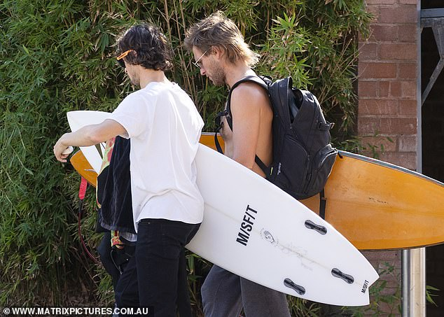 Surfs up!The blonde heartthrob was also joined by a male friend for for the surf
