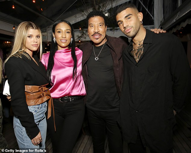 Family matters: The social media personality and her older sibling are shared by singer-songwriter Lionel Richie and his former wife Diane Alexander: The three are seen with Lisa Parigi in February of last year