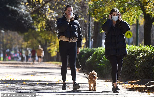 Victoria's Acting Premier James Merlino on Wednesday announced the state's lockdown would be extended for another seven days. Pictured are women exercising in Melbourne