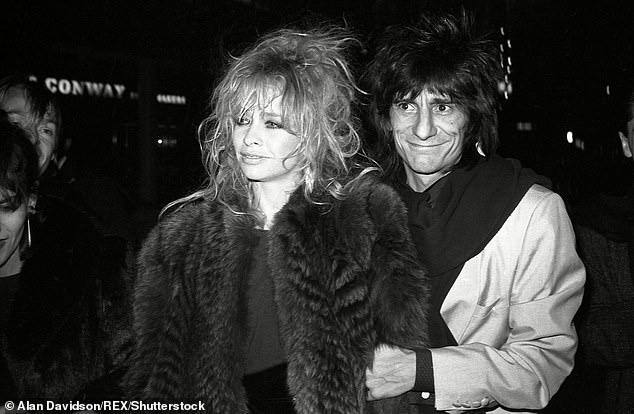 Exes: Ronnie was married to Jo Wood for 26 years before their separation and subsequent divorce in 2011 (pictured in 1984)