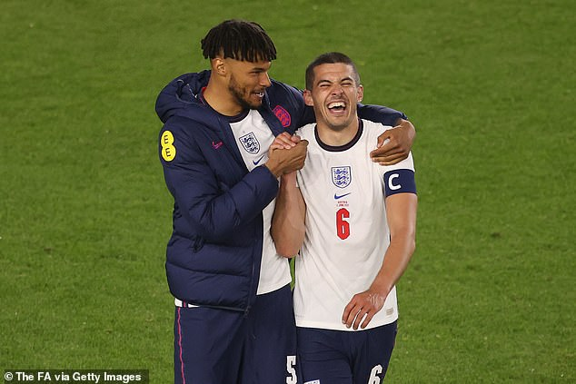 Mings shares a joke with his defensive partner Conor Coady following the friendly victory