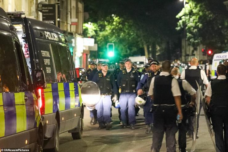 Rocks and bottles were thrown and a police van was damaged by large groups