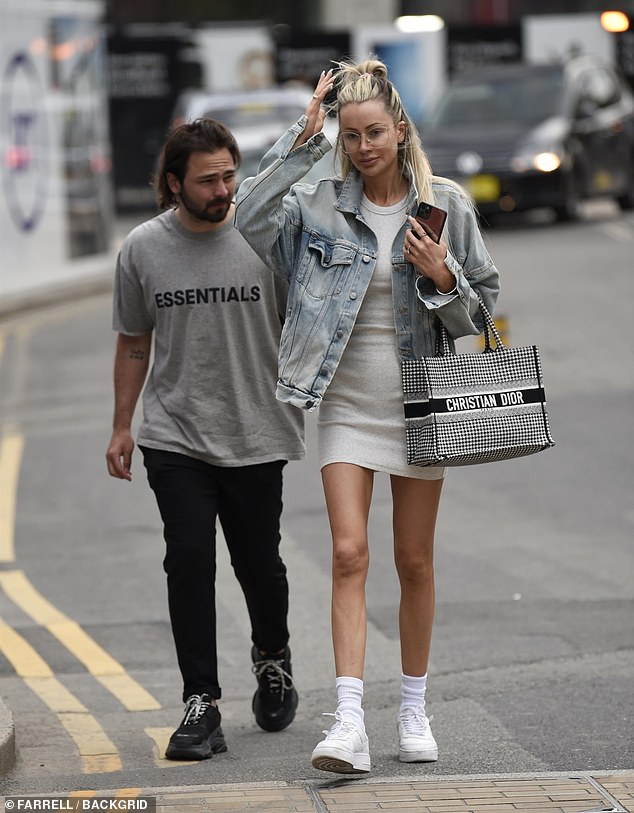 Stepping out: Olivia Attwood headed out for lunch at Menagerie Bar and Restaurant in Manchester with her fiancé Bradley Dack, 27, on Wednesday