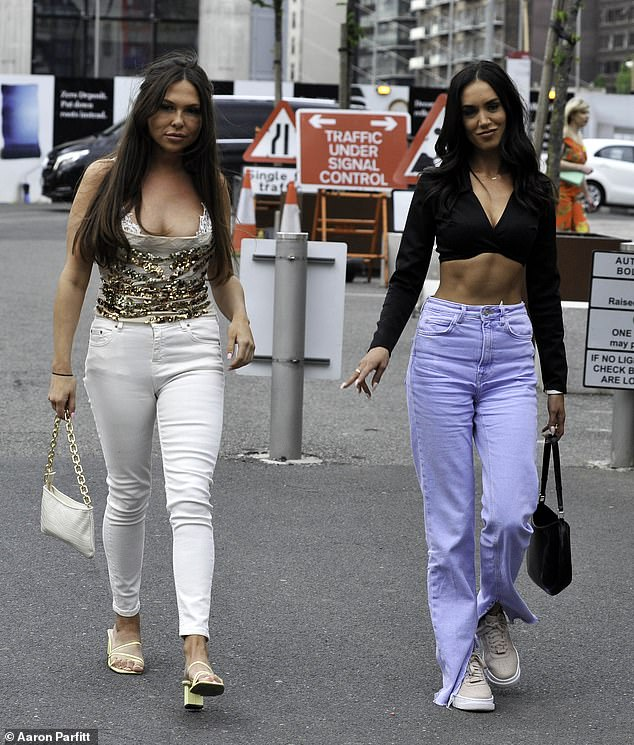 Hitting the town: The girls appeared in high spirits as they headed into the restaurant