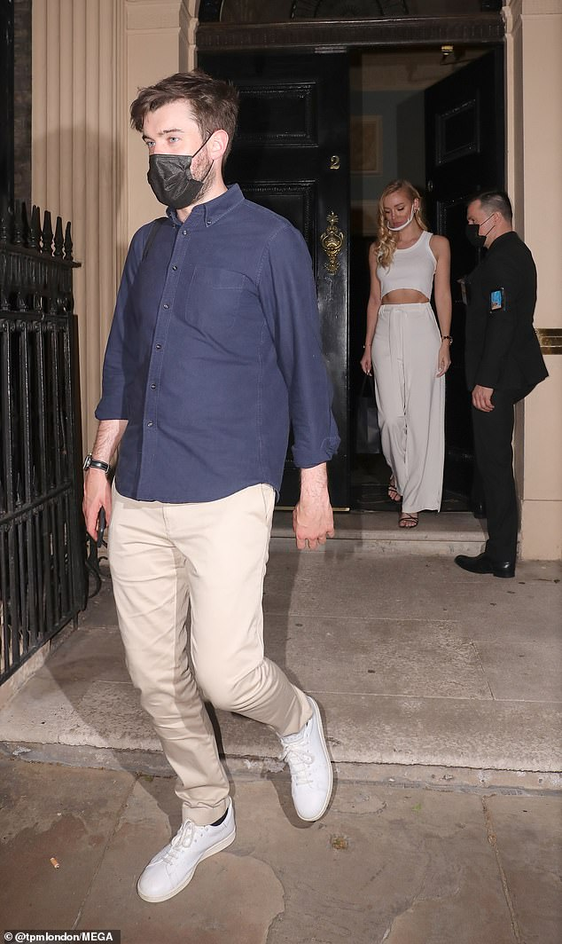 Evening out: Jack wore a black face mask as he left the venue, with Roxy following shortly behind