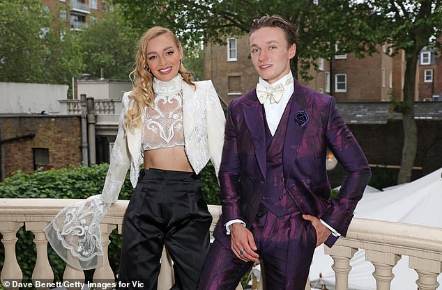 Dressed to impress: She rubbed shoulders with Harrison Osterfield at the VIP dinner