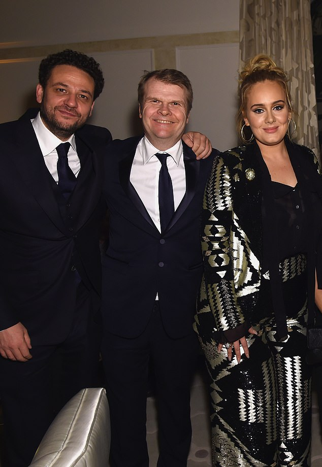 Long term relationship: British-born Dickins (left) began representing Hello hitmaker Adele (right) in 2006, while his sister Lucy serves as her agent. The pair seen here with Columbia Records chairman Rob Stringer (center) in 2017