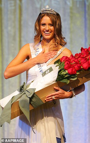 Hand to heart: Jesinta is all smiles after receiving her crown