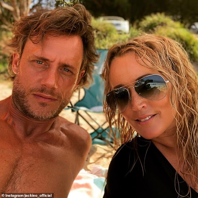 Experimental: Jackie said while she didn't have a strong 'desire' to try pegging, she 'probably' would if a partner wanted her to. Pictured with her ex-husband Lee Henderson