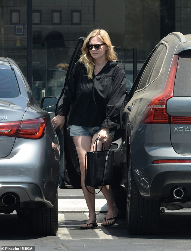 Refreshing: After getting her caffeine fix at Coffea in Burbank, the 39-year-old expectant star was seen rocking a loose-fitting black blouse, matching flip flops and dark brown shades