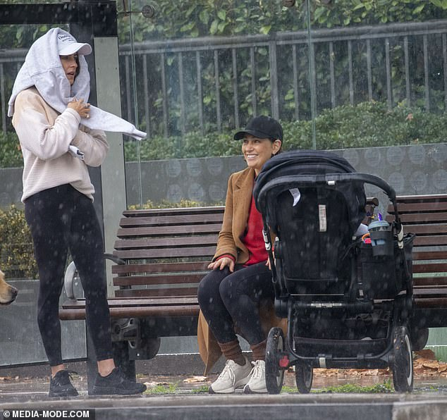 Makeshift umbrella! At one point, she used her grey sweater to cover her head from the rain