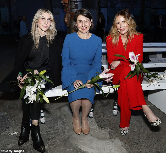In good company: The New South Wales Premier, 50, was seated next to her sister Mary Berejiklian and fashion executive Natalie Xenita for the Indigenous Fashion Projects runway