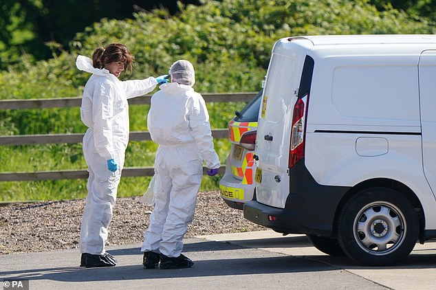 Forensic officers on scene after Boulton was arrested nearby after police launched an extensive manhunt