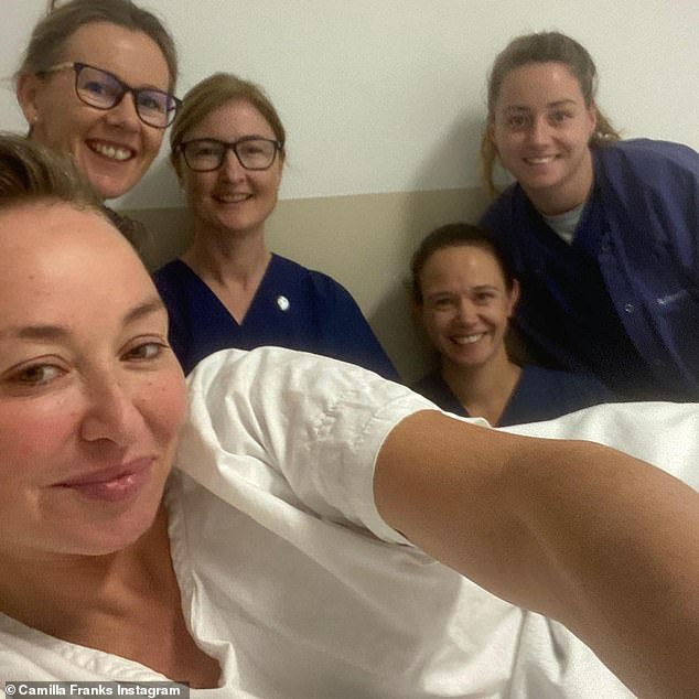 Fight of her life:She said of her three-year-old daughter Luna, 'I had to fight to save my life. A life which is so much more precious now that I have a little girl who loves and needs me.' Pictured is Camilla with her nurses after her lifesaving surgery