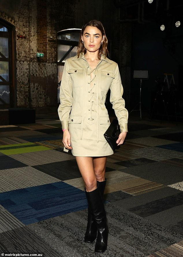 Stepping out in style: Bambi rocked a camel-coloured mini dress with lace-up front detailing at the Fashion Week shows on Monday