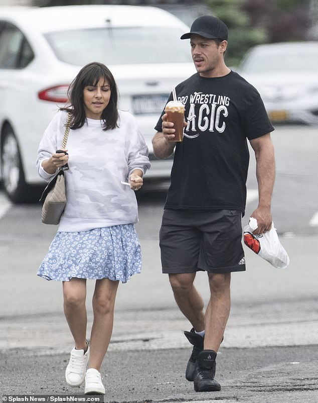 Out and about:Roxanne Pallett, 38, proved she andhusband Jason Carrion were happier than ever as they headed home after enjoying lunch together in New York City on Tuesday