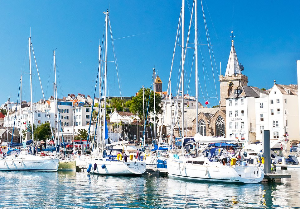 Lively: If you fancy an island break this summer, Guernsey makes an idyllic and sensible choice. Pictured, the charming harbour in St Peter Port