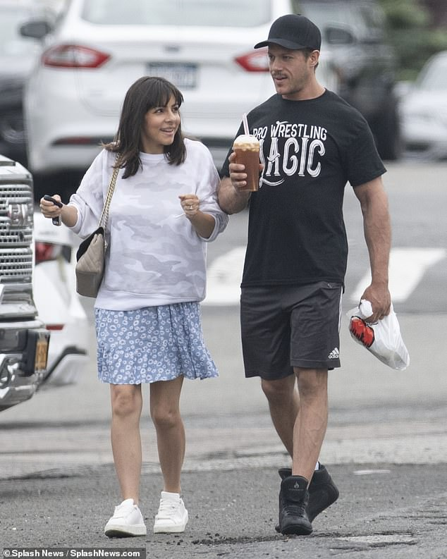 Did you have a nice time? The couple exited their lunch together with their drinks in hand