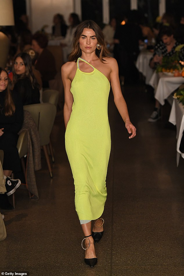 Dress to impress: She stepped out in a figure-hugging yellow dress with a grey fabric underlay and one-shoulder design
