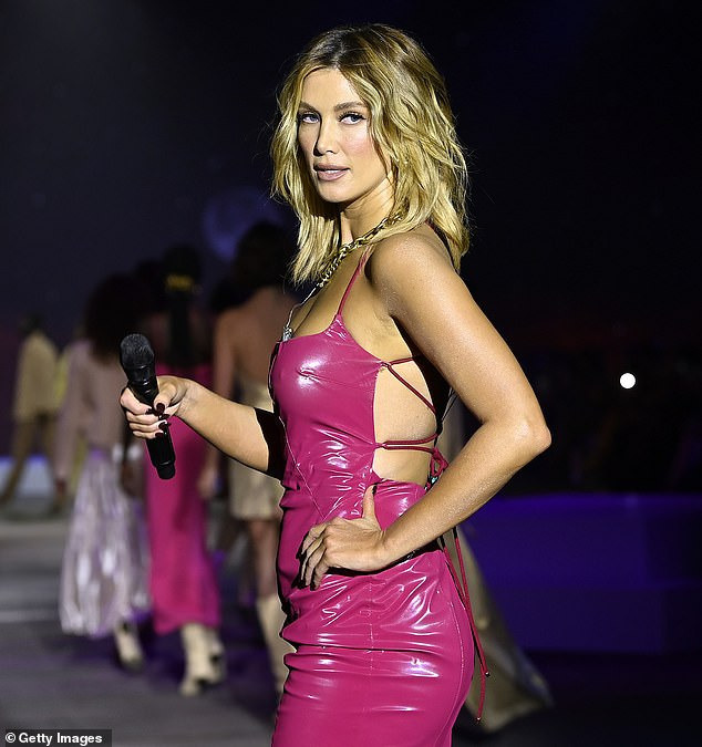 Wows the crowd:She kept her fans on their toes as she performed her hit songs as models walked the runway during the Manning Cartell show