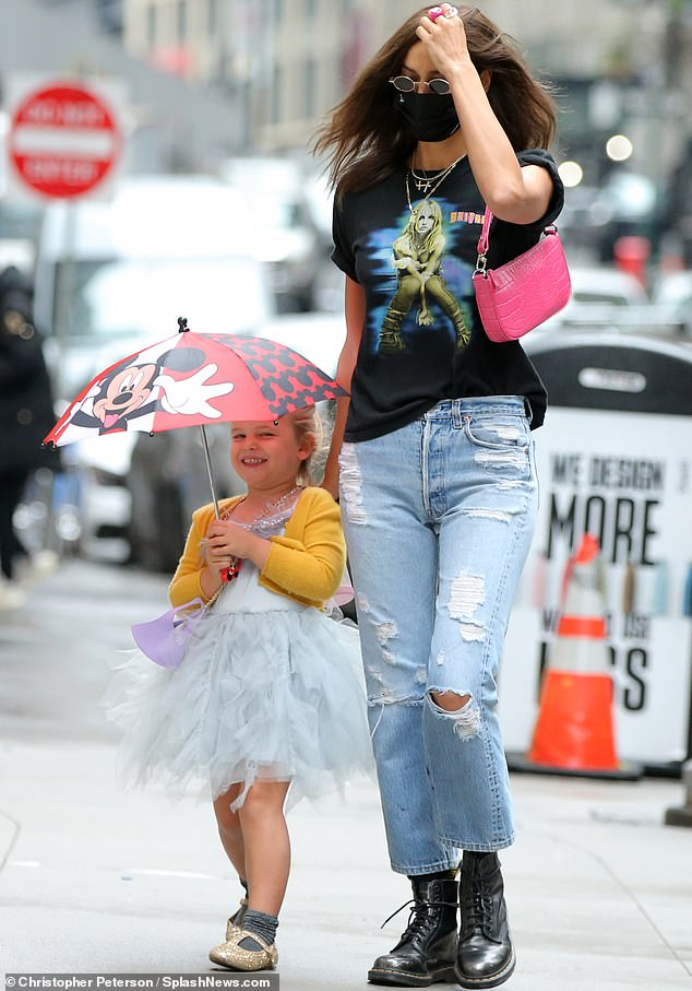 Looking amazing:Irina added an extra pop of color to her outfit by carrying a hot pink handbag for her outing with her little girl