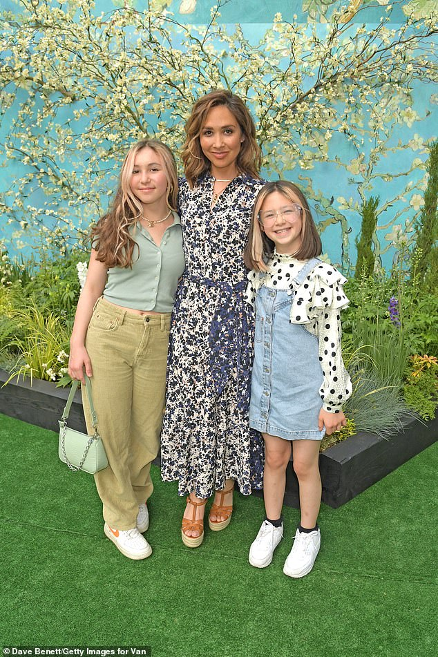 Family: Myleene posed for the camera alongside her daughters Hero, 10, and Ava, 13, at the art event in London