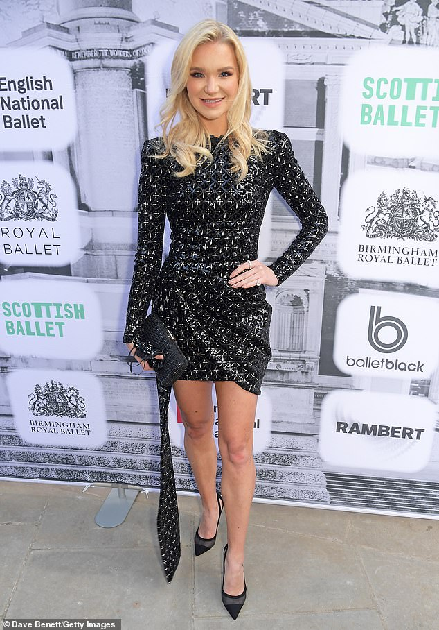 Gorgeous:Abbie wowed in a black sparkly gown
