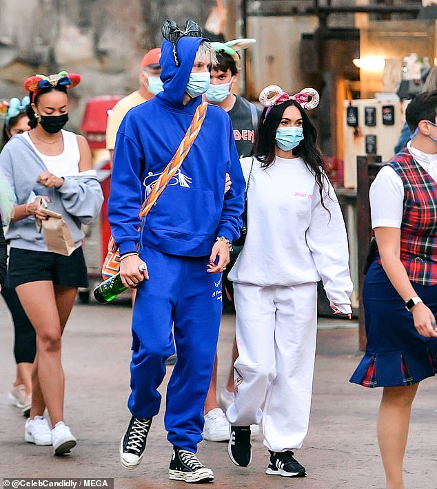 Matchy matchy:As if they needed to look even more simpatico, the two also donned baggy sweatsuits as they enjoyed the sights and sounds at the highly-popular theme park