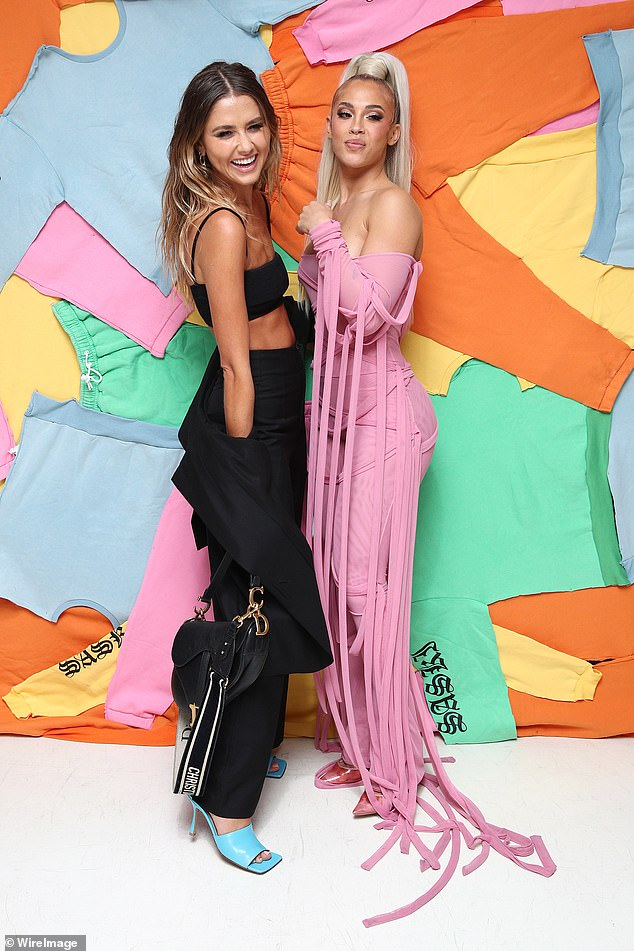 Barbie girl:There was certainly no missing Tammy, who attended the fashion show for her athleisure wear clothing line in a figure-hugging strapless pink jumpsuit