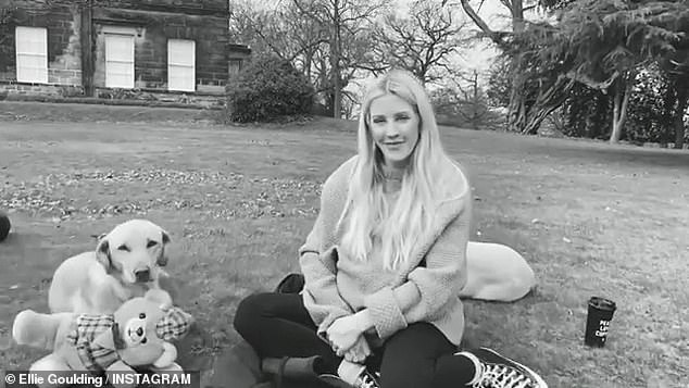Fur babies: In a different part Ellie is glowing as she poses with their pet dogs outside