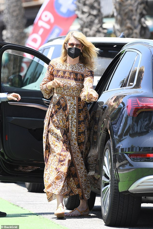Flowing:The 54-year-old actress strolled down the sidewalk in a smocked ankle-length dress that was covered in images of elephants and flowers