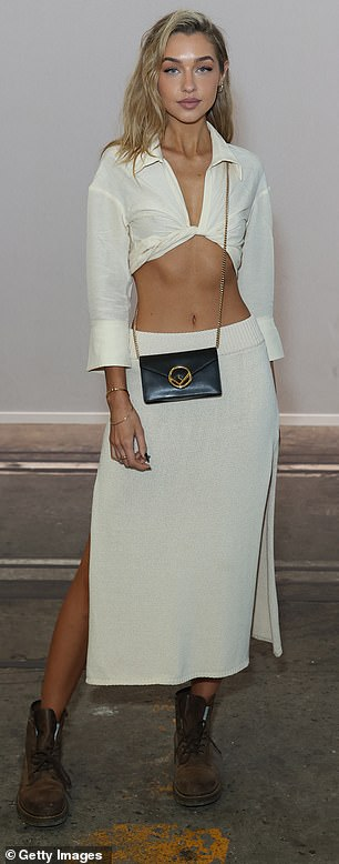 Perfect balance: For accessories, the blue-eyed and blonde-haired beauty kept it simple, adorning herself with gold jewels and toting a small black leather designer bag