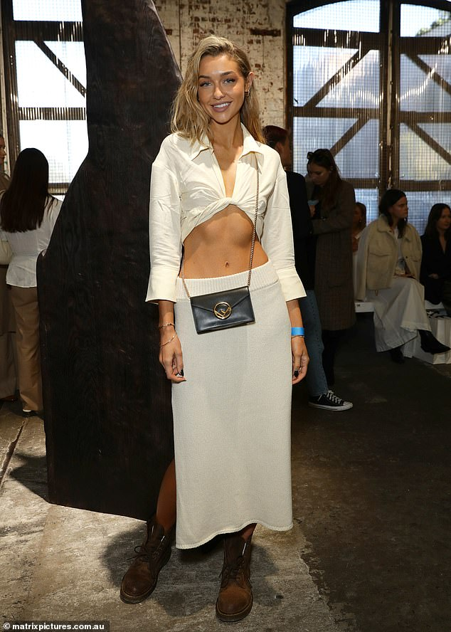 Ab-tastic!The 25-year-old turned heads in a cropped white shirt which was knotted at her ribs to expose her toned abs