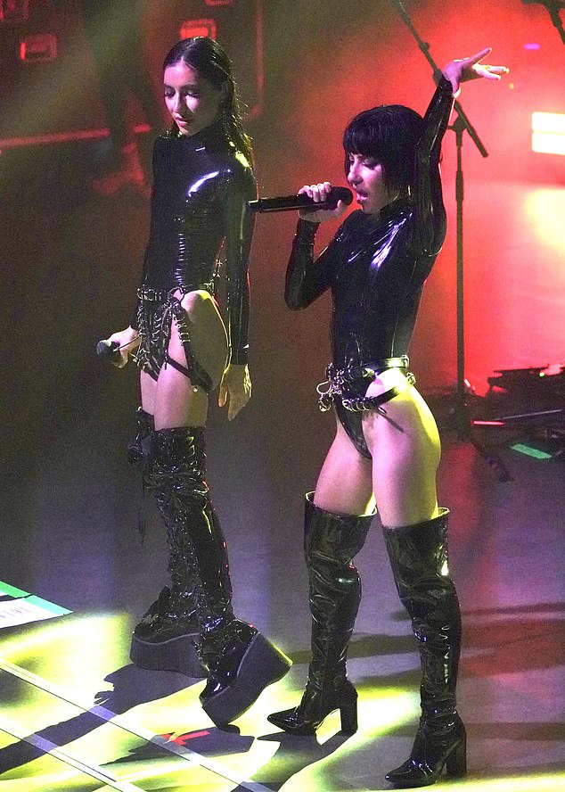 Racy display: The pop twins, 36, thrilled fans as they performed in S&M-inspired bodysuits that highlighted their petite figures
