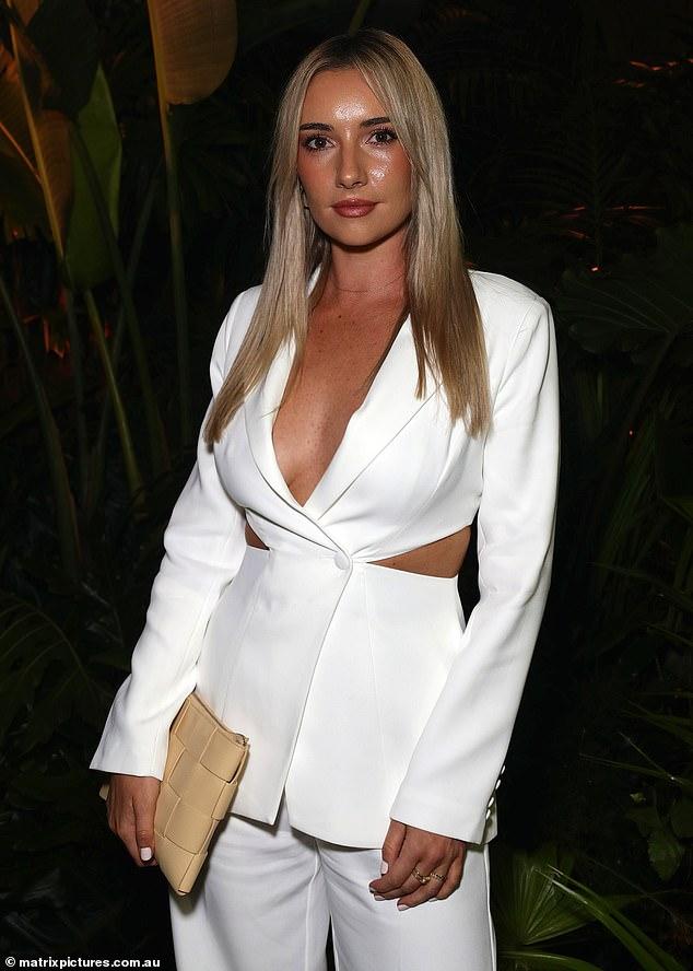 Hot! Former Bachelor star Bec Cvilikas turned heads at Australian Fashion Week in Sydney on Thursday in arevealing white tuxedo from Meski