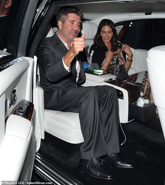 What's that?Simon Cowell, 61, has been spotted with what appears to be a portable oxygen tank as he headed home after a dinner date with partner Lauren Silverman, 43, on Thursday