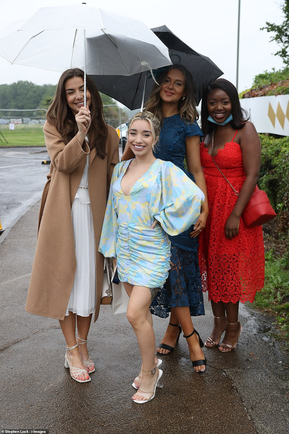 Strike a pose! Epsom racegoers didn't let the rainy weather conditions stop them from putting on a glamorous display as they arrived at Epsom Downs Racecourse in Surrey for Derby day. Pictured, front centre,British former professional boxer Nicola Adams' girlfriend Ella Baig