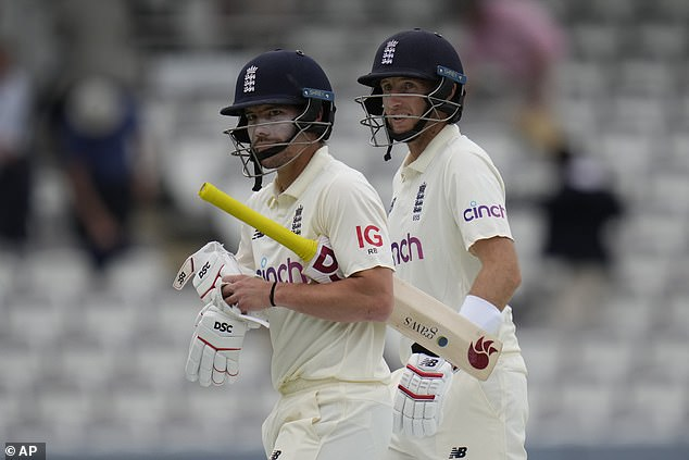 Rory Burns (left) and Joe Root (right) leave the pitch at the end of day two with England 111-2