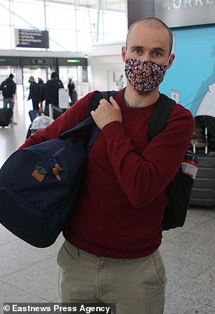 Josh Clements, 29, who arrived back to London Stansted with his partner today after a holiday in Portugal, almost couldn't board his flight due to a government computer bungle