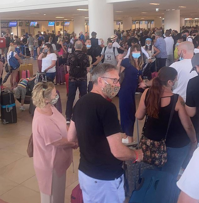 The UK's second largest tour operator originally suspended its services up to June 24 when the green list was announced. Pictured, travellers at Faro Airport last Sunday, standing in a queue of 100 people snaking round six times where only three check-in desks were open for as many as six flights going back to the UK