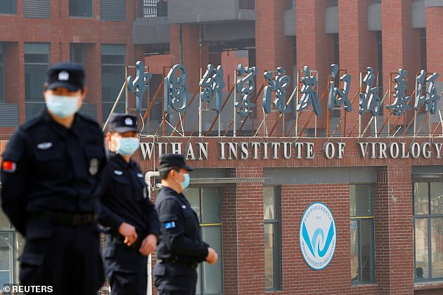 Security personnel keep watch outside Wuhan Institute of Virology during the visit by the World Health Organization (WHO) team in February