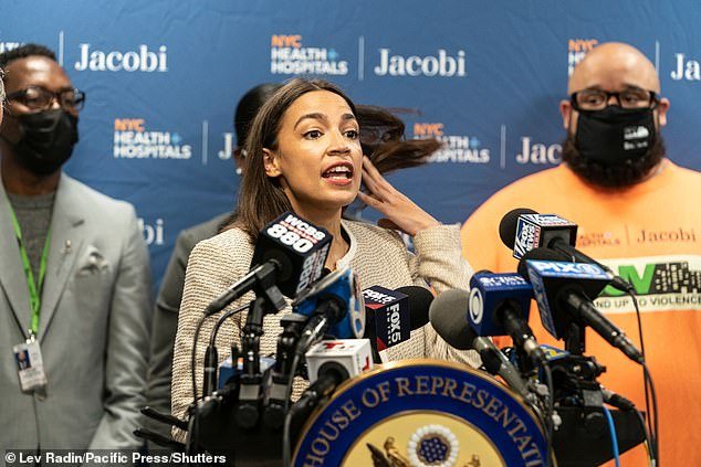 Alexandria Ocasio-Cortez (pictured at a press conference Thursdayuhas been slammed for saying the 'answer' to tackling New York City's violent crime epidemic is to stop building jails and using them 'as garbage bins for human beings'