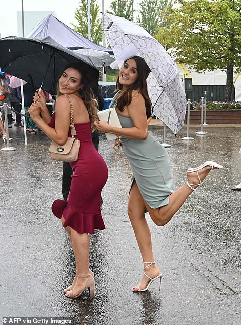 No rain on their parade! Epsom racegoers looked like they were determined to have a fun day despite the unseasonably bad weather