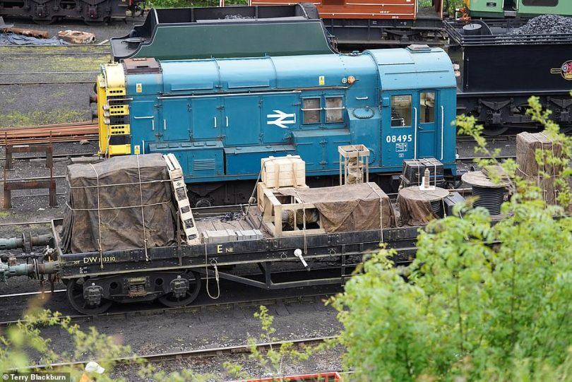 Setting the scene: A number of props were set up on the carriages behind the redesigned train to make it look like a Nazi cargo engine