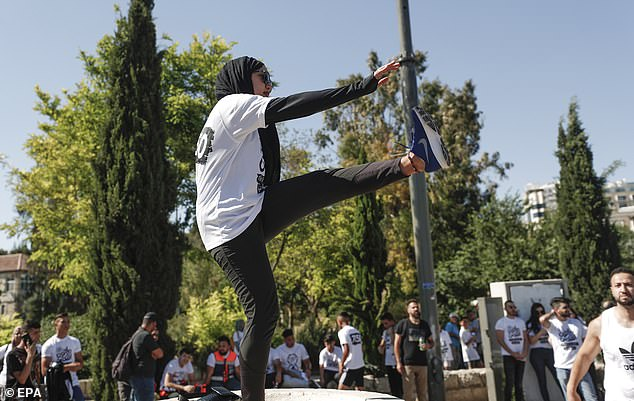 A woman stretches ahead of a marathonin solidarity with Sheikh Jarrah families and against the eviction of the Palestinian families