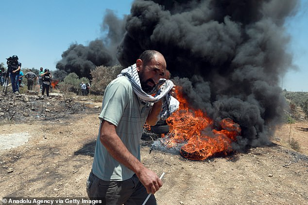 Pictured:Palestinians burn tyres during a protest against Jewish settlements in Nablus, West Bank on June 04, 2021