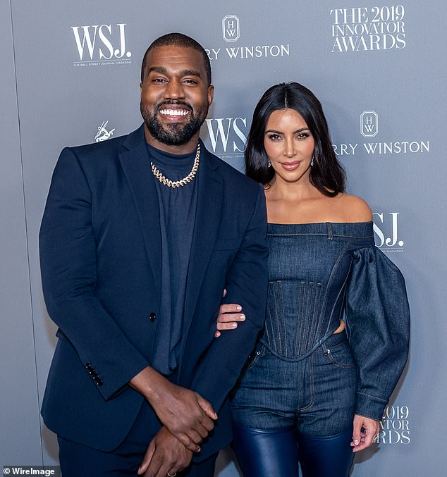 No regrets: The insider also told the media outlet that Kardashian was 'convinced that she made the right decision' in filing for divorce; she is seen with West in 2019