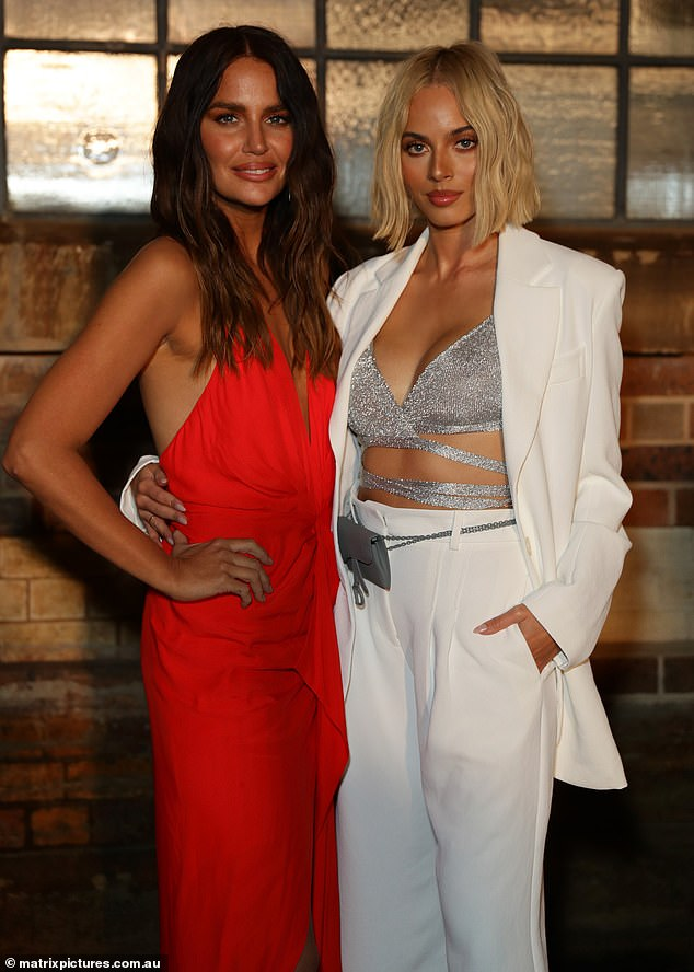 Gorgeous: The mystery lookalike stunned this week as she stepped out in a cream blazer, matching trousers, and a sparkly silver bra and even rubbed shoulders with Jodi Gordon