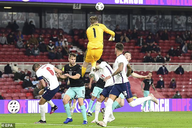 Pickford leaps to clear the ball during England's friendly win over Austria on Wednesday